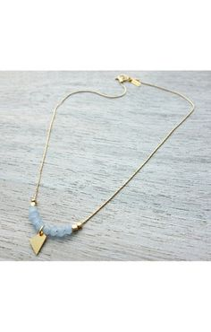 Shlomit Ofir Triangle Pendant Necklace.   http://www.shopcloakroom.com/collections/jewelry/products/single-strand-triangle-pendant-necklace-by-shlomit-ofir