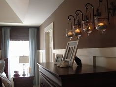 The Yellow Cape Cod: DIY Projects I love those hanging candle lanterns over the chest!