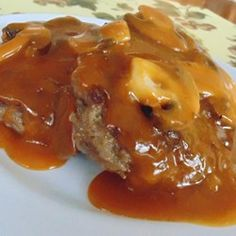 Salisbury steak is a classic American comfort food. This basic version is quick and easy to assemble thanks to the use of prepared golden mushroom soup. Homemade Salisbury Steak, Salisbury Steak Recipes, Salisbury Steak Recipe With Golden Mushroom Soup, Meat Recipes, Cooking Recipes, Hamburger Recipes, Hamburger Ideas, Budget Cooking, Leche Flan