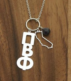 Pi Phi necklace- cute to have the state you attended on there too!
