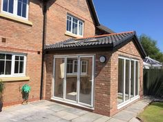 Sun room extension with bi-fold doors - McKnight & Sons Builders Conservatory Dining Room, Conservatory Extension, Conservatory Design, Orangery Extension Kitchen, Conservatory Interiors, House Extension Plans, House Extension Design, Rear Extension, Extension Ideas