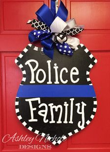 Show your support with this door hanger! Saying can be changed to suit your needs. All of our door decorations are proudly hand painted in the USA. Includes matching fun bow. Made of 1/4 plywood. Painted with outdoor quality paint. Painted black on the back for that polished look. 24 tall x 20 wide
