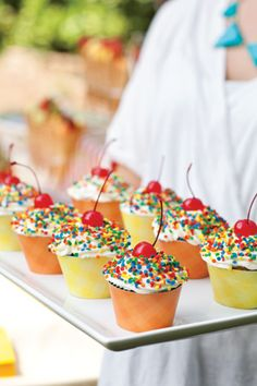 Carnival Cupcakes -  Confetti sprinkles and a maraschino cherry provide just the right amount of nostalgia for an occasion such as this. Click here for this cupcake recipe.