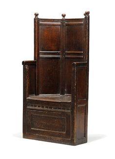 An exceptionally rare mid-16th century oak enclosed box armchair English, circa 1540 - 1560