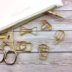 This listing is for one set of 5 gold paperclips. One Ice Cream, one coffee cup, one bow, one diamond, and one camera.  Keep in mind that all monitors are different, color of product may differ slightly from photo.  Custom orders and wholesale pricing available. Please contact us for more information.  *Please read shop/shipping policies under the Announcement section on our shop page. Current coupon codes can be found there as well! ----------  Free Digital Downloads! http://b...