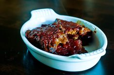 Okay y'all, I have the easiest recipe to share with you for BBQ Pork Chops. This is one of those recipes in my arsenal of secret weapons against the busiest of weeknights when I know I need to have a trick or two up my sleeve about supper time. I really hate to even call this a recipe it's so