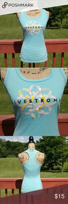 Nike dri-fit tank Light blue Nike racerback tank with 'Livestrong' graphic on front and yellow Nike swoosh on the bottom left front. 100% polyester Nike Tops Tank Tops