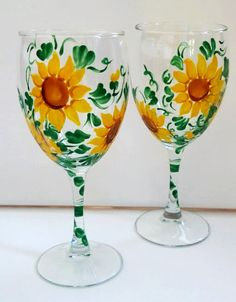 Hand Painted Sunflower Wine Glasses. Hand painted and Sold as a set of 2. These glasses have been painted with special glass paint and baked to ensure dishwasher safeness. $35 Via Etsy