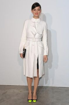 Marion Cotillard looked chic and sophisticated in a white Dior trenchcoat and neon toe-cap pumps
