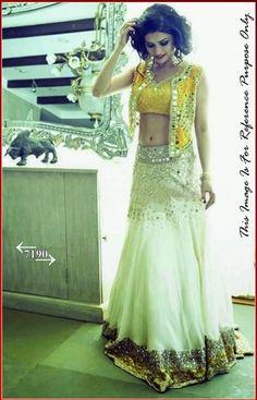 Bollywood Actress Prachi Desai White Featuring Mirror Work Replica Lehenga. Buy Apparel