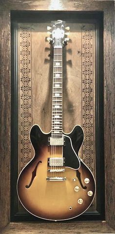 G Frames are custom hand-made in the USA guitar display cases. These guitar shadow boxes are functional art pieces made to hold your best guitars in style. Guitar Wall, Cool Guitar, Guitar Display Case, Frame Display, Guitar Design, Art Pieces, Wall Decor, Handmade, Style