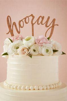 This laser cut HOORAY wedding cake topper created by Alexis Mattox from laser cut cherry wood is available here.