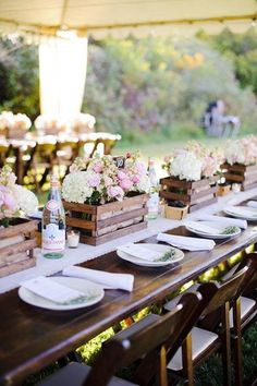 Classy outdoor entertaining.  Love the centerpieces with lots of natural wood.