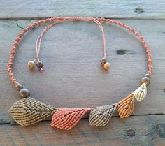 Handmade macrame autumn leaves necklace Materials used: High quality waxed linhasita cord Wooden beads The necklace has adjustable sliding knot so as to adust the length as you like. If you have any questions about this product, Ill be happy to answer them. Made by CraftyMargie