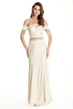 Two Piece Set Full Length Lace Evening Dress has Cropped Bodice with Strapless Neckline and Low Back with Zipper Closure. Flowing Long Skirt with Beading Embellished Waistline Completes the Style.