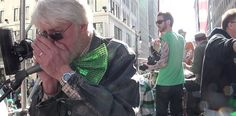 """Tootall on the harmonica for the CHOM band's rendition of """"Desire"""" during St. Patrick's Day Parade."""