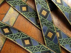 WARLORD, MUSTARD, SLATE BLUE, OLIVE GREEN ON BLACK jacquard trim