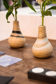 Woodturned vases with recycled plastic bands designed by Lucentia and Sarah Thirlwell - Photography by @Yeshen Venema