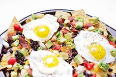 Breakfast Nachos | How about some nachos for breakfast? Yep, you can enjoy your favorite game day snack with a breakfast twist. @bfota