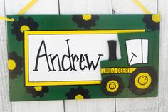Hey, I found this really awesome Etsy listing at http://www.etsy.com/listing/98438912/john-deere-tractor-kids-sign-name-door