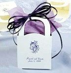 Favor Tote Box     Enhance your table setting with this lovely favor tote box that you can fill with mints, candies or a small favor gift. It is personalized with your first names, wedding date and foil color with design of your choice.