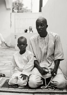 "yagazieemezi: "" Father and Son at the Mosque during Corite Sicap, Karack Dakar, Senegal 2011 While taking portraits in Dakar, I began to notice that subjects would pose by looking up and off into the distance. I thought maybe it was just me until I..."