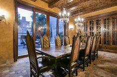 Tuscan style Formal Dining Room with wine cabinet and view to private courtyard