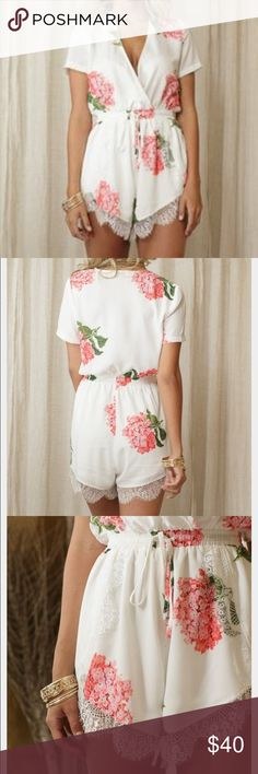 White floral Lacey romper Size Small cute romper. Worn twice. I added a clip to keep the top from being super open but is easily removable & doesn't need to be clipped. Asking $40 OBO. Other