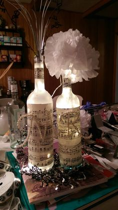 Music note theme centerpieces from old liquor bottles.