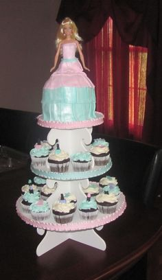 Barbie Cupcake Tower and cupcakes via Cake Central