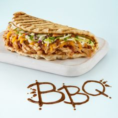 Our new flatbread has arrived right on cue. Barbecue! Enjoy the perfect summer bite of hand-pulled chicken, coleslaw, cheddar cheese & sweet BBQ sauce. #BBQChickenFlatbread