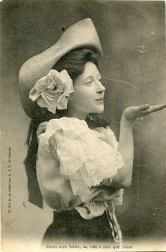 Original French vintage tinted real photo postcard - Lady blowing a kiss