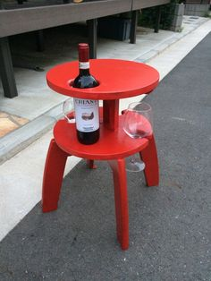 A Frosta wine table hack with holes to hold the bottle and glasses. So they don't tip over when you get tipsy.