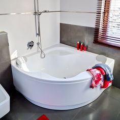 Corner Bathtub with shower.