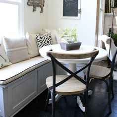 A new table and chairs gives this little dining nook a farmhouse inspired look.
