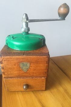 Want a pop of vibrant green in your curated kitchen? This vintage Peugeot coffee grinder is the perfect heritage accent. Coffee Grinders, Vintage Coffee, Vintage Green, Peugeot, Home Accessories, Conditioner, Vibrant, Pop, Metal