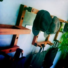 a great idea for a coat/hat rack: simply use wood pegs secured to an interesting sub structure