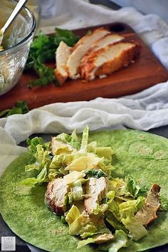 Packed with all the flavors of a classic Caesar salad, this easy recipe for a Chicken Caesar Salad Wrap makes a delicious lunch on-the-go or even a light and tasty dinner. It is easily converted to be gluten free too! Chicken Caesar Wrap, Chicken Caesar Salad, Fast Healthy Meals, Healthy Eating, Healthy Recipes, Yummy Recipes, Dinner Recipes, Spinach Tortilla Wraps, Classic Caesar Salad
