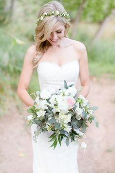 bride in flower halo and pink and white bouquet