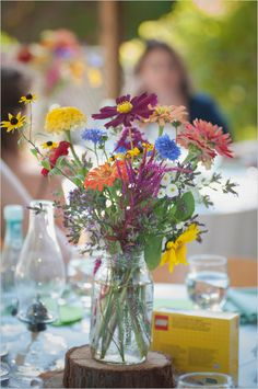 colorful wildflower centerpiece #weddingreception #wildflowers #weddingchicks http://www.weddingchicks.com/2014/02/26/fun-and-feisty-forest-wedding/