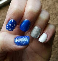 Gel nail art...blue, white, silver sparkle and dots
