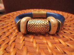 Metallic royal blue licorice leather bracelet with iridescent beige ceramic slides and dimpled antiqued bronze focal slide