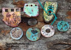 SEt of 7 pendants and connectors. All hand formed, texturized, painted and sealed. By Terri Wlaschin