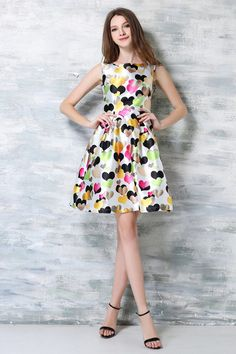 This adorable dress is a fabulous addition to any closet. A colorful choice that is perfect for the summer season! $21.99