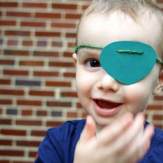 ACTIVITY: Photo Booth Props. DIY Pirate Eye Patch using Paper Source Peacock Cover Solid Paper (8 1/2 x 11 Peacock Cover Paper - 10 Pack). Creative & Photography: Chris Norman. Model: Owen Griffith. Template for Eye Patch: http://www.supermommoments.com/2011/07/pirate-playdate-sets-sail/
