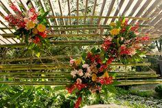 lush, bamboo summer ceremony decor