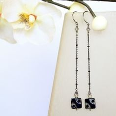 Matching Madison Square Earrings to the necklace! It's made out of jet black picasso Czech glass flat squares and genuine Swarovski crystals suspended from a delicate black chain.