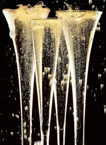 Photography of champagne being poured, spilt, splashed with fizz and bubbles.  Still life photography by David parfitt www.davidparfitt.com