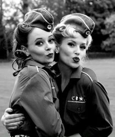 1940s World war 2 - The women still look pretty with make up and red lips, up-do hair, allthough they are wearing army clothes with thicker fabric, unlike those dresses that we see in the 20s, 30s.