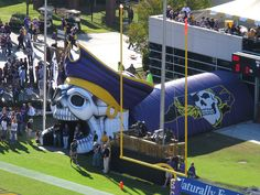 Here's the entry for the ECU Pirates. This thing smokes like crazy as the football players plow through. Ecu Football, College Football, Football Players, Ecu Pirates, East Carolina University, Pirate Life, Monster Trucks, House Ideas, Game